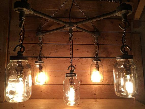 Hanging Mason Jars in an 'X' Formation industrial steampunk ceiling light with vintge cables and vintage edison candle light bulbs