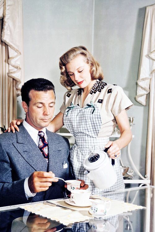 June Allyson serves coffee to her husband, Dick Powell, 1947