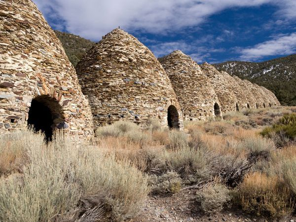 Kilns at Wildrose    Photograph by Pete Ryan    Get close enough to the ten beehive-shaped structures that serve as the starting point for the Wildrose Peak Trail in Death Valley National Park and you might smell smoke—but don't panic, it's just a lingering smell from old kilns, which were built in 1876. The kilns were used to process silver and lead ore and are no longer in operation today.