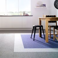Create a framework using different colors of the same carpet tiles.