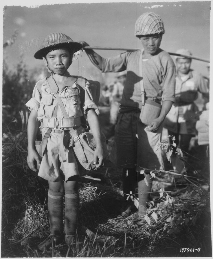 This Chinese soldier, age 10, with heavy pack, is a member of a Chinese division which is boarding planes at the North Airstrip, Myitkyina, Burma, bound for China., 12/05/1944