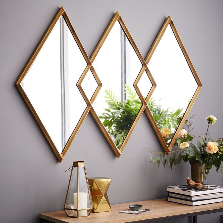 A geometric antique brass finished frame mirror is a perfect accessory for the modern home