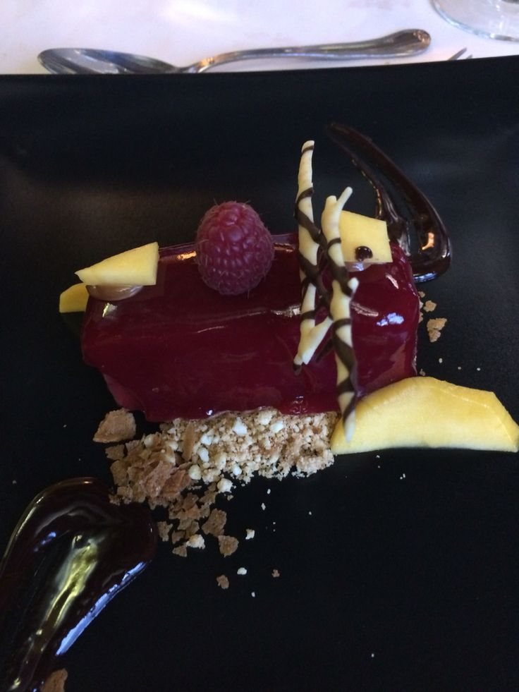 Olive oil chocolate mousse with strawberry and framboise jelly cover.