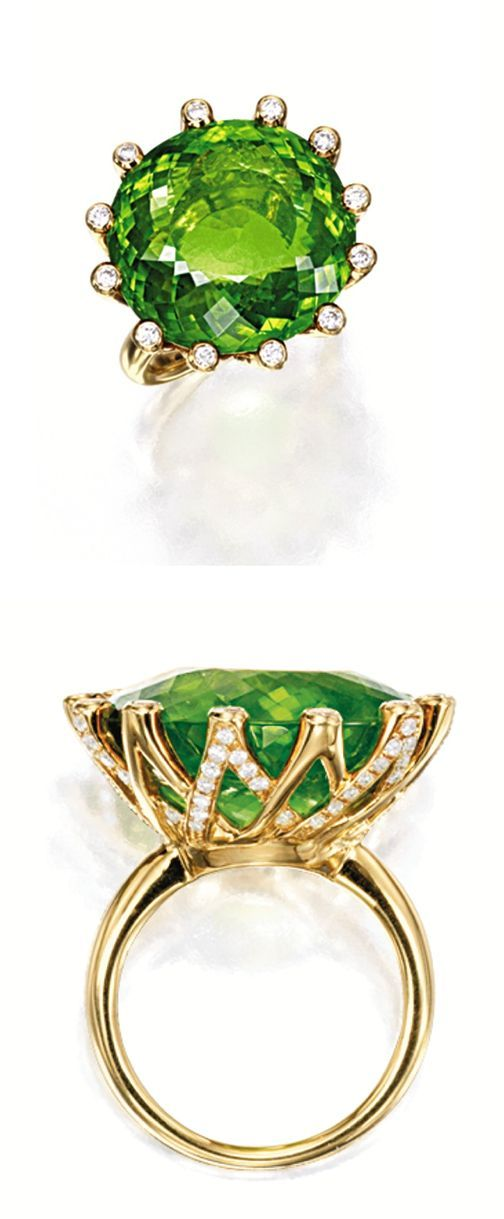 PERIDOT AND DIAMOND RING, LAUT Centring on an oval peridot weighing 30.64 carats, to a stylised mount embellished by brilliant-cut diamonds, mounted in 18 karat yellow gold, signed and numbered 7252