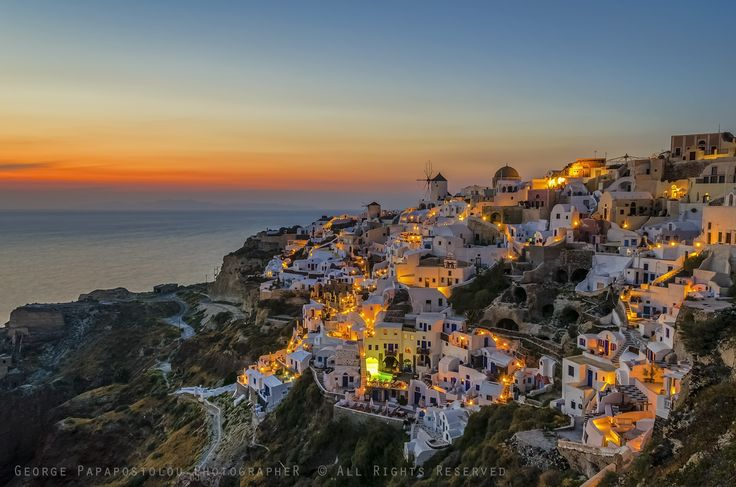 Colorful sunset in Oia village Santorini Greece  George Papapostolou PhotographeR  © All Rights Reserved
