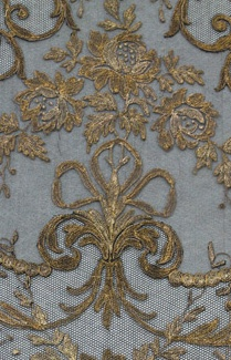 Beautiful blue fabric with gold embroidery -- for furniture, draperies, pillows, even wall coverings.