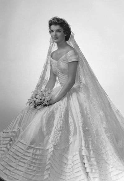 Jacqueline Bouvier: The future first lady (and fashion icon) wore a voluminous ivory silk taffeta gown by the designer Ann Lowe when she married John F. Kennedy in 1953. A portrait neckline and wide, embellished skirt emphasized Jackie's small waist, and an heirloom lace veil, which originally belonged to her grandmother, completed the super-romantic ensemble.