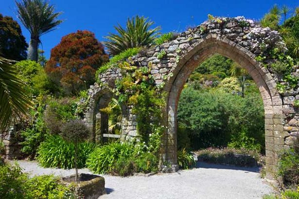 Old stone archway from the ruined abbey in the sub-tropical Abbey Gardens, Island of Tresco (Pic: Getty Images)