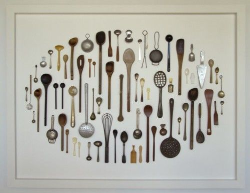 This wall hung display of kitchenalia is quite effective. The overall oval shape of the display gives it a nice  finish.