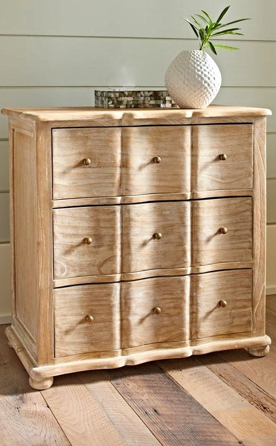 """With the presence of a lucky """"find"""" you spotted in a vintage shop, our three-drawer Mira Chest is a charming nightstand alternative. It's crafted for us of Mindi wood, also known as white cedar, a wood naturally resistant to decay."""