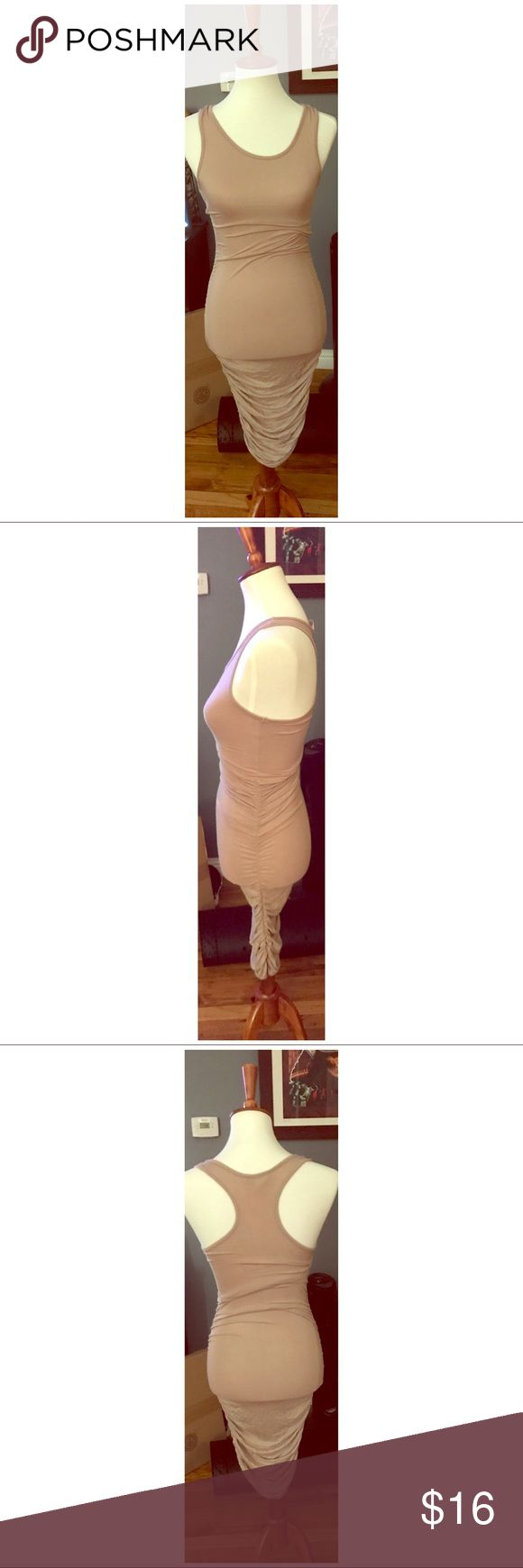 Nude Camel Bodycon Midi Tank Dress This dress has ruched sides and is a midi length. It has a tank top style upper. Size small. Fashion Nova Dresses Midi