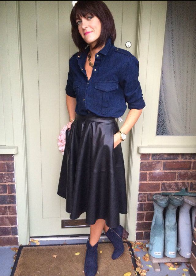 jane from my midlife fashion pairs a dark chambray top with a midi leather skirt what i wore