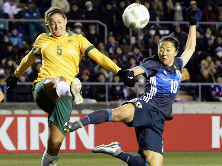 Japan's Yuki Ogimai, right, and Australia's Laura Alleway battle for the ball during the women's soccer final round of Asian qualifying for the 2016 Rio de Janeiro Olympics in Osaka, Japan. Australia beat host Japan 3-1.  Yu Nakajima, Kyodo News, via AP