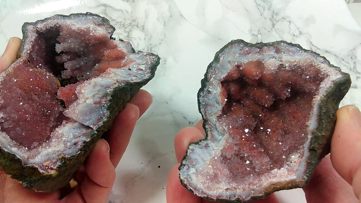Who wouldn't want to find a rock, crack it open and find this stunning beauty inside? This is a crystal geode from Morocco. It is filled with Amethyst crystals and stalactites, some tinted with Hematite (we have come across pieces like this marketed as 'Hematoid Quartz'). Natural beauty! www.EAGems.com