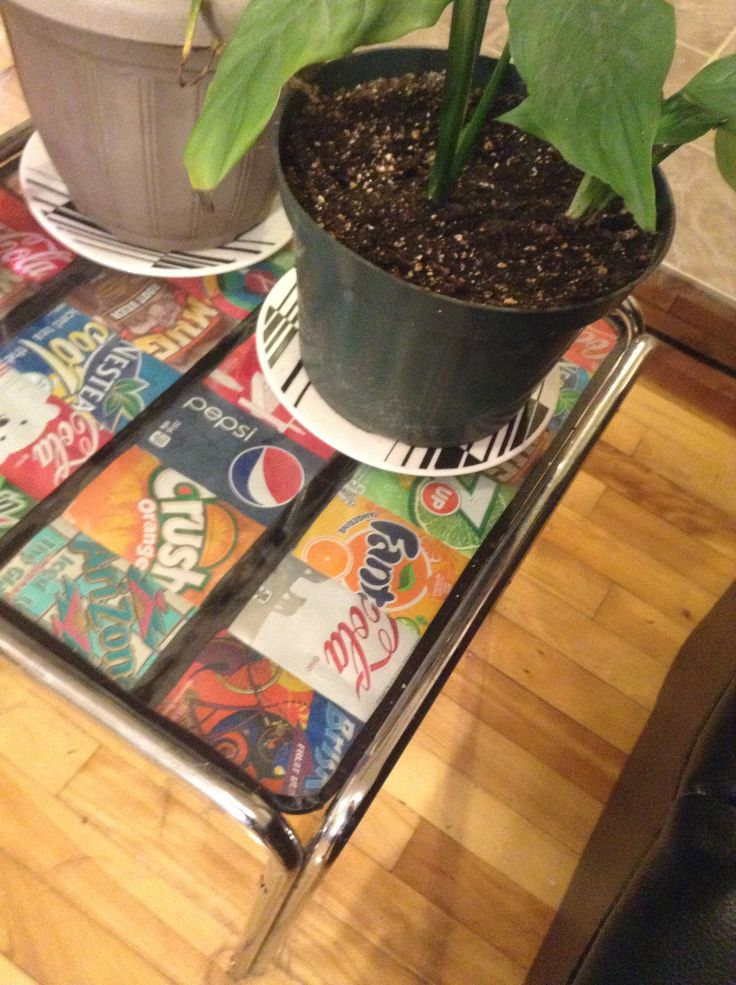 Recycled cans used to upcycle old glass side table.