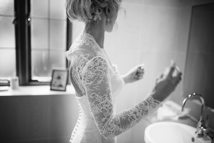 Image by Modern Vintage Weddings - Suzanne Neville Lace 'Antonia' Wedding Dress and Jenny Packham Bridal Accessories for a traditional wedding ceremony in Peterborough Cathedral and a reception at Stapleford Park. Bridesmaids wear pale pink dresses and Groomsmen in tails.
