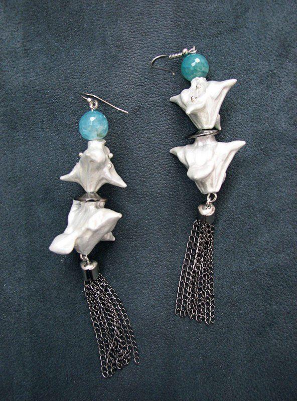 Long earrings made of Trapa Natans seeds, semiprecious stones and nickel-free metal.  www.iasoltanei.ro