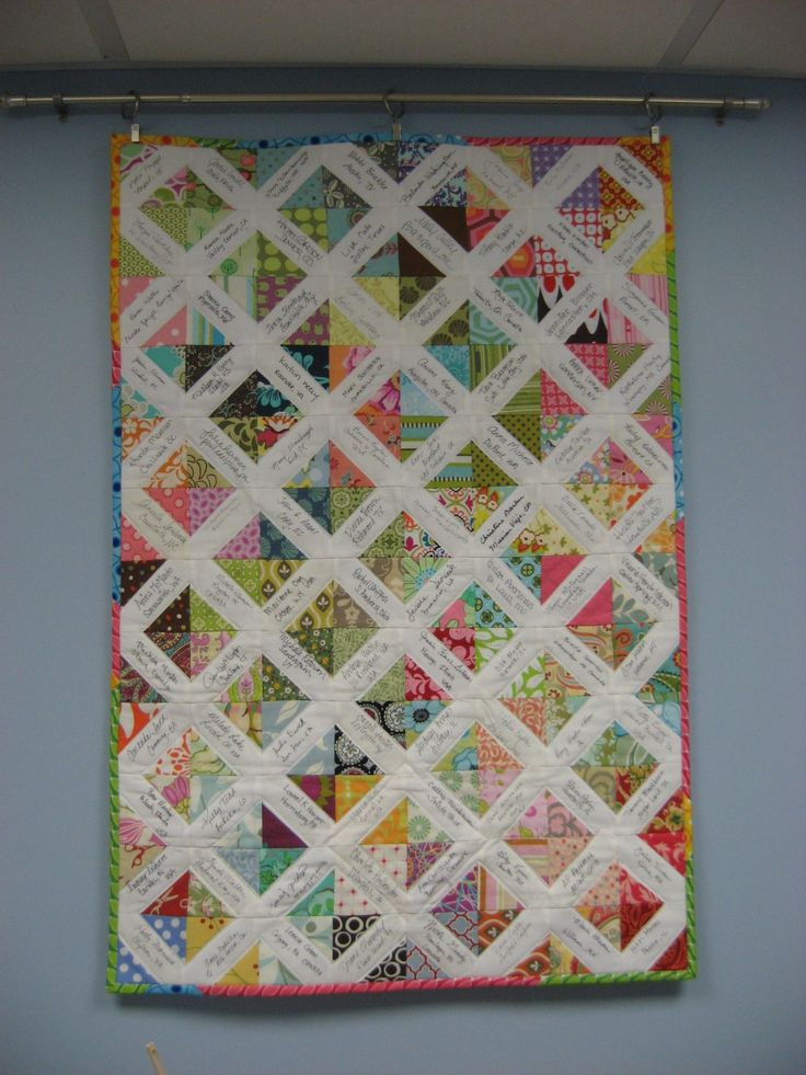 What a bright and cheerful signature quilt. This looks like the design I might use for my sister's wedding quilt. Gorgeous!
