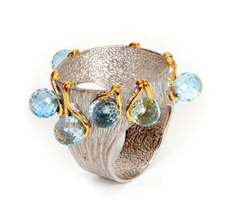 G.Kabirski - Material: silver 925° - Gems: blue topaz - Plated: rhodium  gold.