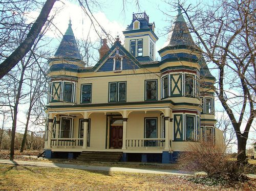 Looks like a turret on each corner of this old Victorian house.