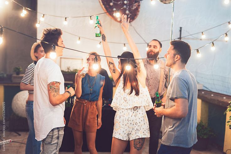 Group of Friends at Rooftop Party. by Lumina for Stocksy United