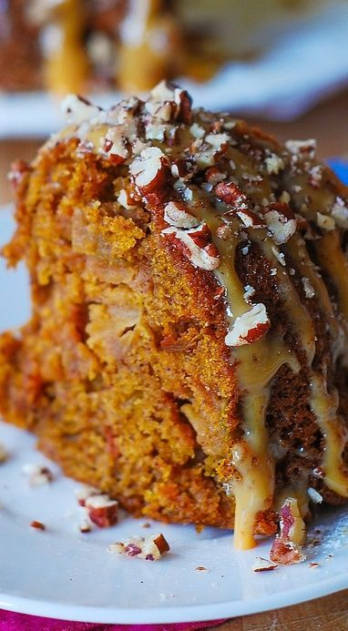 Apple pumpkin bundt cake with caramel and pecans. It's like having Autumn on your plate! It will make a great addition to your dessert menu for Thanksgiving!
