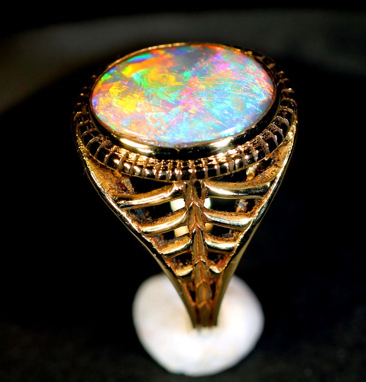 Fine 14kt gold art deco style ring set with a 3.5ct black opal. Ring designed and handmade by James Wilson. Opal cut by James Wilson.          eagleNY@gmail.com