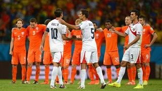 Bryan Ruiz (L) of Costa Rica is consoled by Celso Borges (C) and Giancarlo Gonzalez (R)