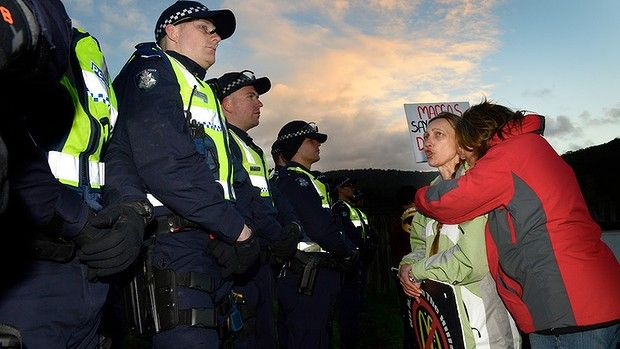Protesters and police at the Tecoma McDonald's site, where a woman has been removed from the roof this morning. McDonalds hired 50 police officers to come in at 4:00 a.m., in pre-dawn darkness to arrest a lone 24 year old protester. What's next? Water cannons?