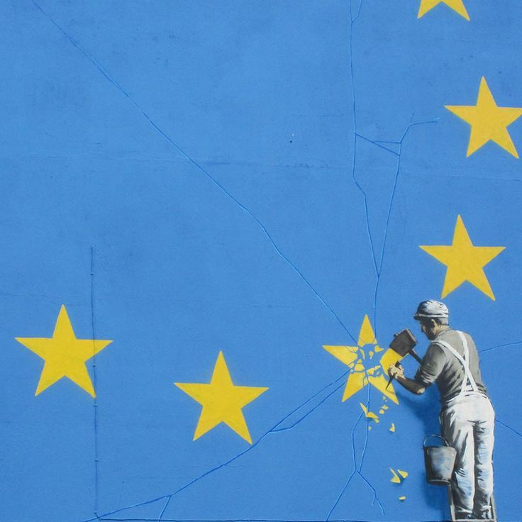 banksy takes on brexit: mural shows metalworker chipping away at the EU flag