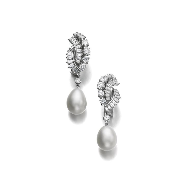 Pair of natural pearl and diamond ear clips, Boucheron, circa 1950 Each set with a drop shaped natural pearl measuring approximately 11.00 x 11.30 x 12.80mm and 10.80 x 11.20 x 13.55mm, suspended from a surmount of brilliant-cut and baguette diamonds, each signed Boucheron, numbered, French assay marks.