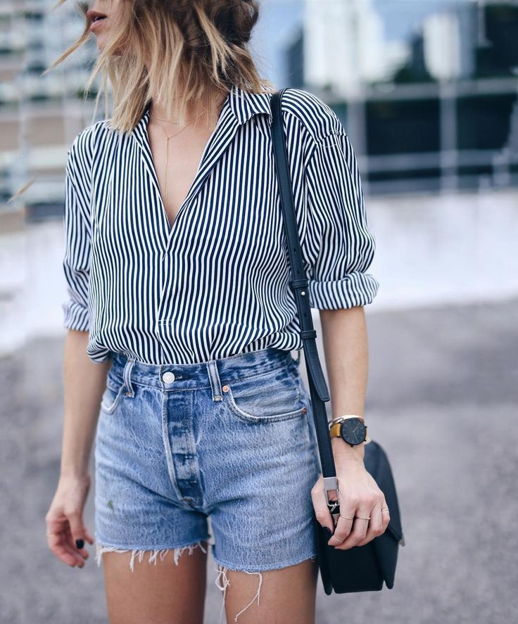Striped shirt and denim shorts.