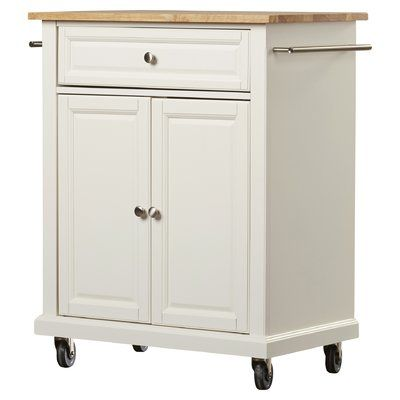 Anchor the heart of your home in transitional appeal with this handsome one-drawer kitchen island, crafted from manufactured wood and showcasing four wheels. Its interior storage is perfect for stowing your favorite cookbooks or extra table linens, while its side shelf acts as a makeshift spice rack. Pairing a clean-lined design with an understated rectangular silhouette, this island blends effortlessly into a variety of settings. Play up this piece's traditional influence by adding it to...
