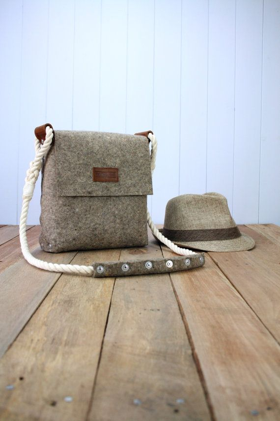This messenger bag is handmade from 3 mm industrial wool felt, which is assembled using pop rivets. The strap is made from hand spliced and whipped cotton