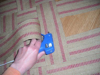 If the glue gun scares you try carpet tape.....How to make a rug from upholstery webbing