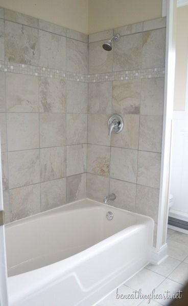 Tub re-finiished using kit from Lowe's ... see comment and reply dated 9/2/13 for more info