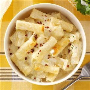 Baked Ziti with Cheese Recipe -This pasta dish, made with Alfredo sauce, is deliciously different from typical tomato-based recipes. Extra cheesy, it goes together quickly and is always popular at potlucks. —Lisa Varner, El Paso, Texas