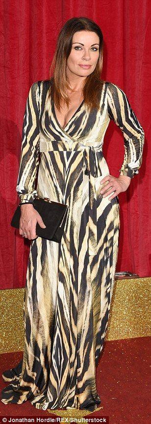 Grr! Alison King was unmissable in a plunging tiger print gown...