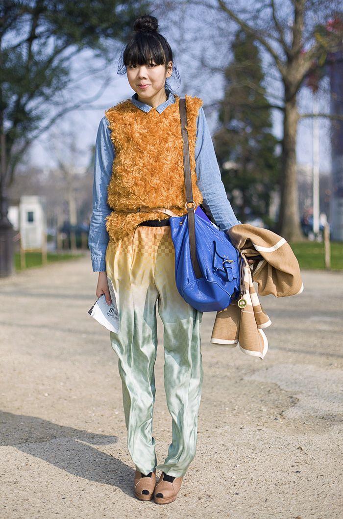 Susie Bubble in Prada, Paris  Vest: Orange Furry PRADA Vest  Shirt: MONKI Denim Shirt  Bag: Blue MULBERRY Bag  Pants: Ombre DRIES VAN NOTEN Trousers  Shoes: CARIN WESTER Shoes  Photo By: Phil Oh