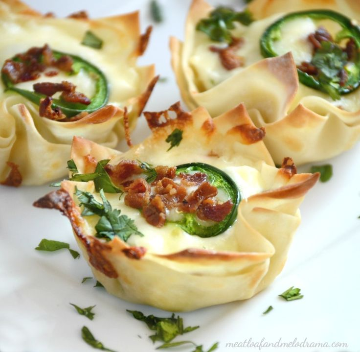 Jalapeno popper cups are filled with cream cheese, jalapeno peppers and mozzarella cheese, then topped with crispy bits of bacon.