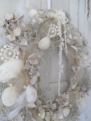 oh my! a wreath of white shells, snippets of lace, feathers...<3<3<3
