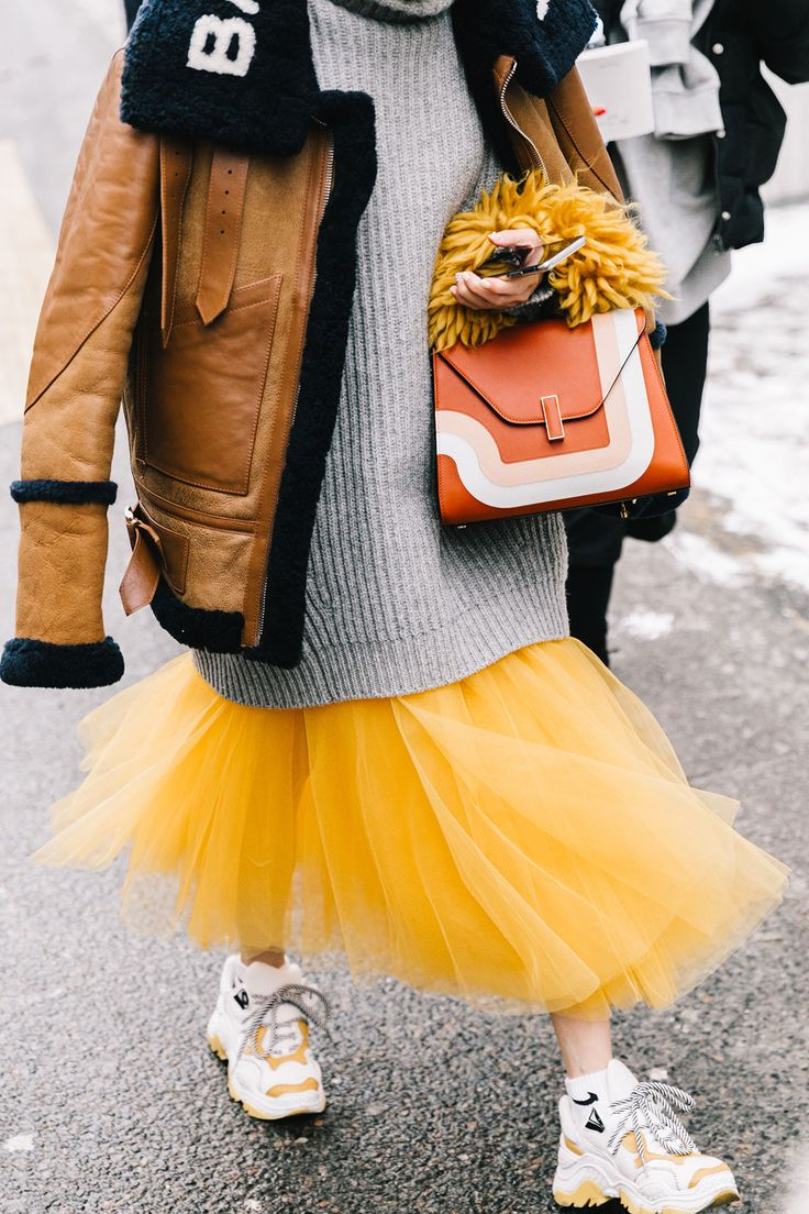 The wonderful eccentricity of yellow tulle, an oversized jersey and some ugly sneakers
