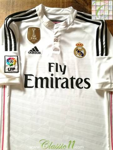 Official Adidas Real Madrid home football shirt from the 2014/2015 season. Complete with La Liga patch on the sleeve and World Club Champions patch on the chest.