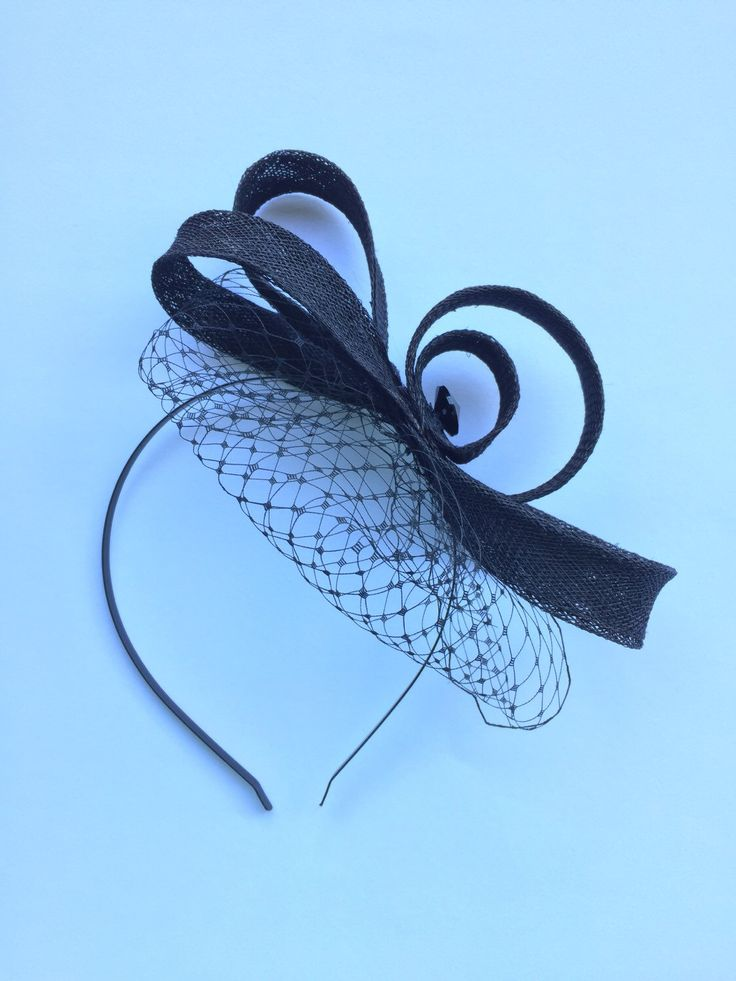A personal favourite from my Etsy shop https://www.etsy.com/au/listing/252089174/high-fashion-black-fascinator-headband