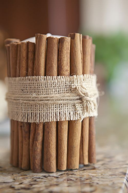 cinnamon sticks and burlap around a candle