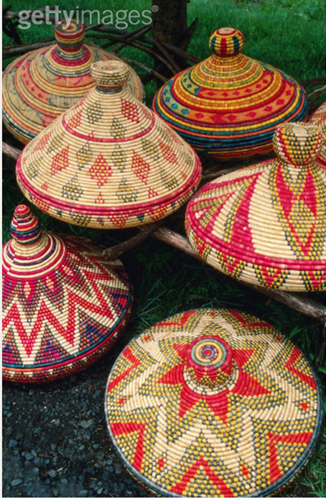 "Africa | Traditional ""injera"" baskets for sale by the roadside. Injera is the pancake used as a base on which to serve almost all meals.  Addis Ababa, Ethiopia 