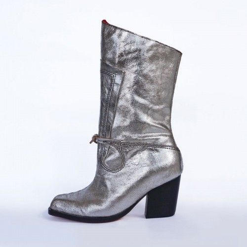 Carabas Boot in silver leather with hand sculpted wooden heels - features signature dovetailed seams and spanish flourishes. #prestonzlydesign #ltdedition #silverleather #metallic #handmadeshoes