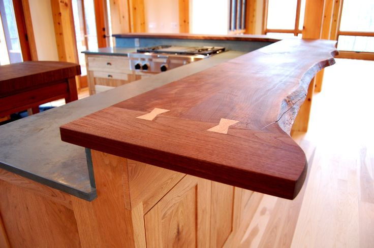 This walnut live edge countertop features butterfly joints for Live wood countertops