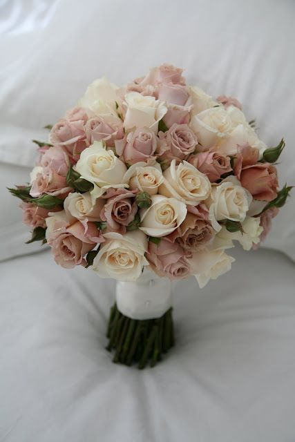 This bouquet would be too big for me but I like the antique-y colour of these roses