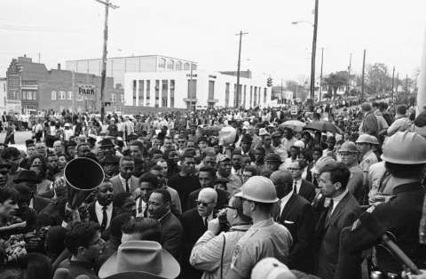 Dr. Martin Luther King, lower left above hat, and several thousand demonstrators arrive at the county court house on March 18, 1965 in Montgomery to protest treatment of previous marchers. The marchers waited in the rain for several house while King met with officials in the court house. (AP Photo) Photo: Anonymous, STF / Beaumont